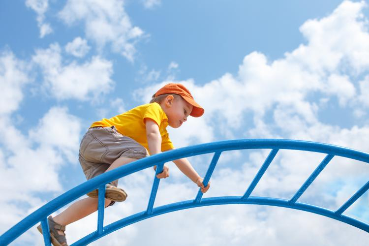 child climbing by EvgeniiAnd/Shutterstock