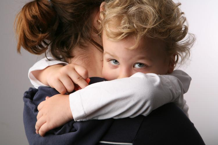 child with mother via Shutterstock